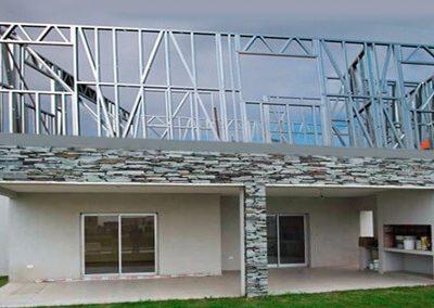 2- Estructura y exteriores en piedra y revoco